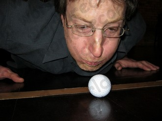 Blowing a golf ball into the Guinness World Records
