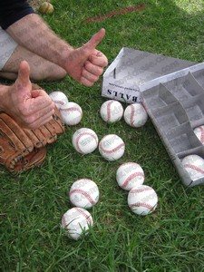Holding 10 baseballs in a baseball glove to set a new world record
