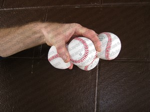 How many baseballs                   can you hold in your hand palm down for a world                   record?