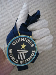 Guiness World Records medal for most gloves on one hand in a minute